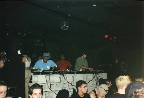 Kenny Glasgow and Mario J work four turntables, summer 1997. Photo courtesy of Gavin Bryan.