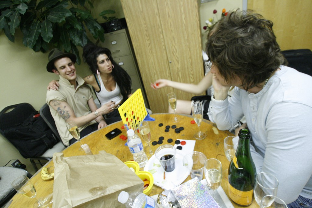 Amy Winehouse (centre) with husband Blake Fielder-Civil and Mark Holmes, backstage in 2007. Photo by Trevor Roberts.