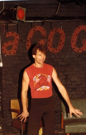 A BamBoo regular dances in front of the venue's beloved A-Go-Go sign. Photo courtesy of Patti Habib.