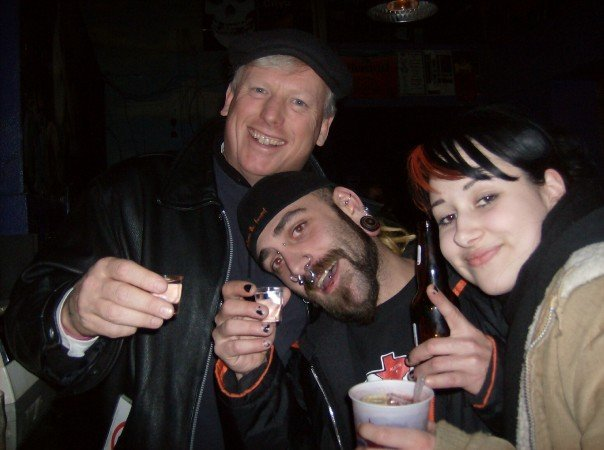 Scoot DeVille (centre) with then-Mayor David Miller, and Reverb bartender Helena. Photo courtesy of DeVille.