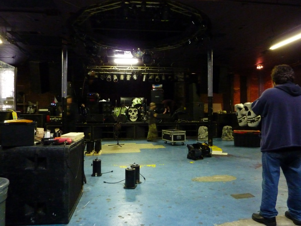 Dominic Tassielli watches the Misfits load in at Reverb. Photo courtesy of Lucy Van Nie.